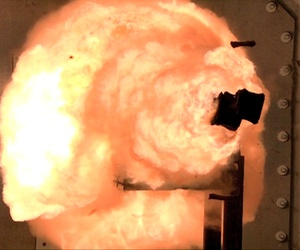 This Thursday Feb. 23. 2012 photo provided by the US Navy shows A high-speed camera captures the first full-energy shots electromagnetic railgun prototype launcher that was recently installed at a test facility in Dahlgren, Va.
