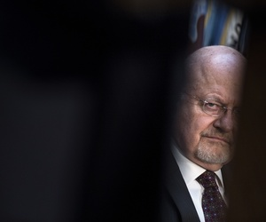 Director of National Intelligence James R. Clapper listens during a retirement ceremony at the National Security Agency Friday March 28, 2014, at Fort Meade, Md.