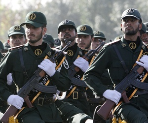 In this picture taken on Sunday, Sept. 21, 2008, Iranian Revolutionary Guards members march during a parade just outside of Tehran.