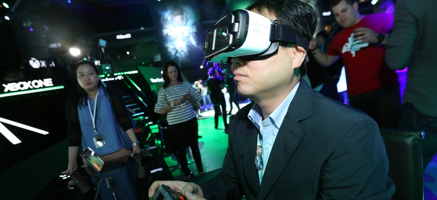 "Gamers experience ""Minecraft"" with Oculus VR at the Xbox Media Showcase at E3 2016 in Los Angeles on Monday, June 13, 2016."