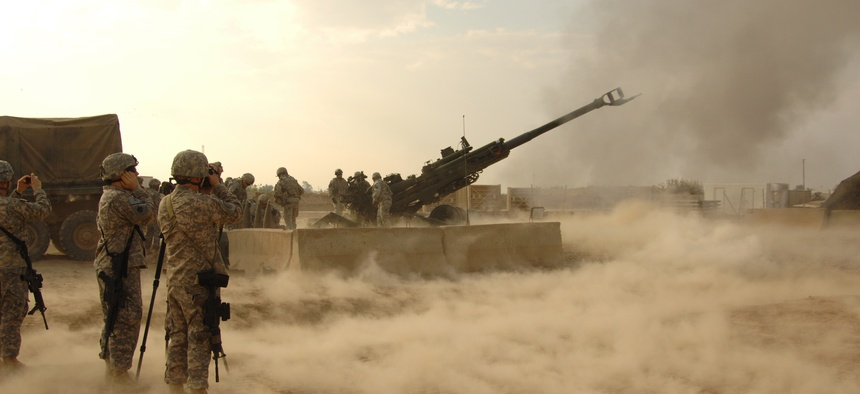 U.S. troops fire rounds to calibrate an M777 howitzer on Forward Operating Base Warhorse, Iraq, Dec. 8, 2009.