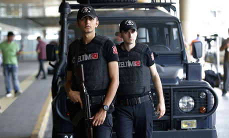Members of Turkish special security force stand at the entrance of Ataturk Airport in Istanbul, Thursday, June 30, 2016.