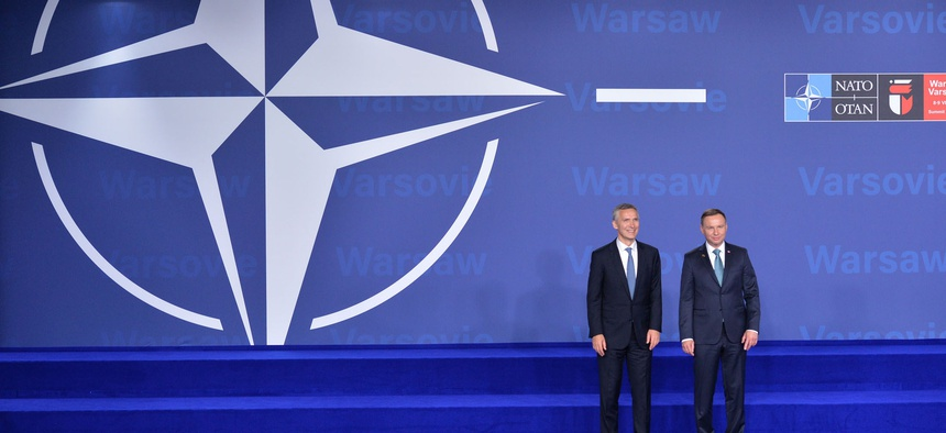 NATO Secretary General Jens Stoltenberg and the President of Poland, Andrzej Duda, pose at the July 8 opening of the NATO Summit in Warsaw.