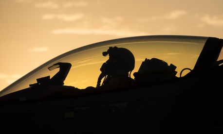 "At Bagram Air Base, Afghanistan, a U.S. Air Force F-16 Fighting Falcon ""Triple Nickel"" aircraft pilot assigned to the 555th Expeditionary Fighter Squadron from Aviano Air Base, Italy, awaits weapons check, July 14, 2015."