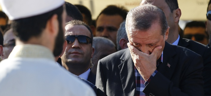 Turkish President Recep Tayyip Erdogan right, wipes his tears during the funeral of Mustafa Cambaz, Erol and Abdullah Olcak, killed Friday while protesting the attempted coup against Turkey's government, in Istanbul, Sunday, July 17, 2016.