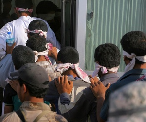 Captured Islamic State fighters are taken away from Fallujah by Iraqi Security Forces, June 1, 2016.