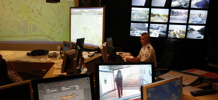 French Police officer checks on video monitors and computer screens in the underground security central command center of the Paris prefecture, in Paris, Wednesday Sept. 22, 2010.