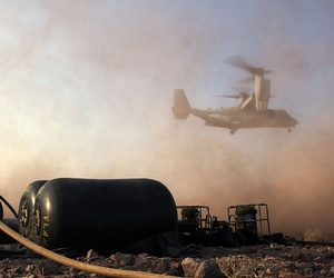 A bulk fuel specialist with Marine Medium Tiltrotor Squadron 365 (Reinforced), 24th Marine Expeditionary Unit, prepares to fuel an MV-22B Osprey at Camp Lemonnier in Djibouti, Feb. 20, 2015.