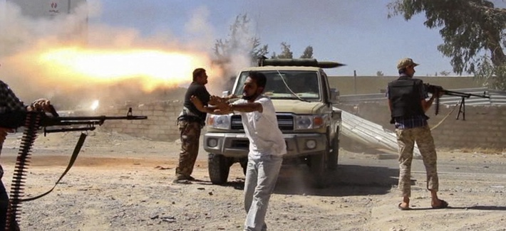Fighters from the Islamist Misarata brigade fire towards Tripoli airport in an attempt to wrest control from a powerful rival militia, in Tripoli, Libya, July 26, 2014.