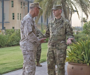 Marine Corps Gen. Joe Dunford, chairman of the Joint Chiefs of Staff, and Army Lt. Gen. Sean MacFarland, commander of Combined Joint Task Force Operation Inherent Resolve, meet in Baghdad, July 30, 2016.