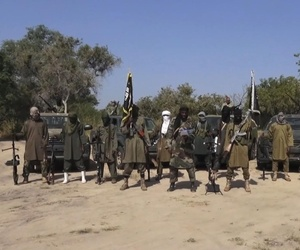 In his file image taken from video released late Friday evening, Oct. 31, 2014, by Boko Haram, Abubakar Shekau, centre, the leader of Nigeria's Islamic extremist group.