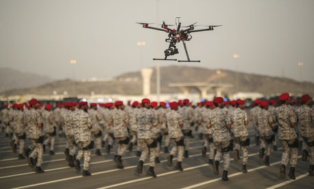 In this Thursday, Sept. 17, 2015 file photo, a drone is used to record a military parade by Saudi security forces in preparation for the annual Hajj pilgrimage in Mecca, Saudi Arabia.