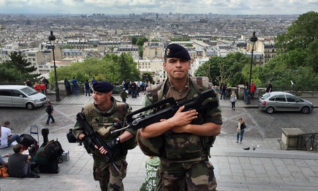 French army soldiers walk up the stairs to Sacre Coeur basilica in Paris, France, Thursday June, 16, 2016.