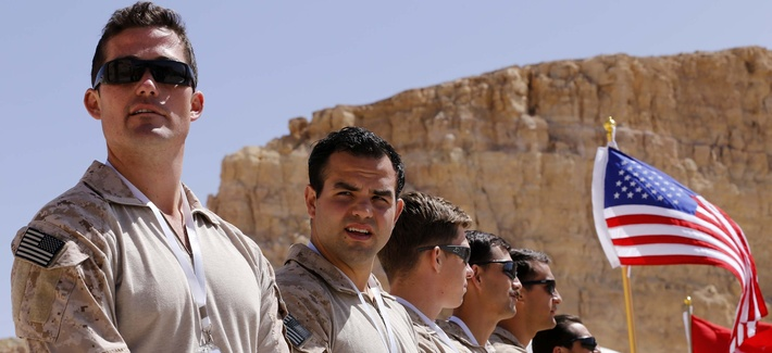 Members of the U.S. military team wait to compete during the 7th Annual International Warrior Competition hosted by the King Abduallh Special Operations Training Center (KASOTC), Sunday, April 19, 2015, Amman, Jordan.