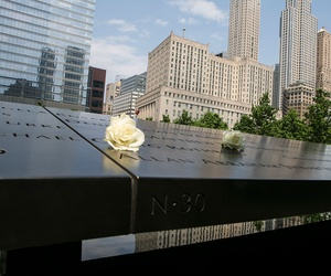 Shadows fall on Pentagon 9-11 Memorial in March.Flowers were left by mourners at the 9/11 Memorial in New Yor
