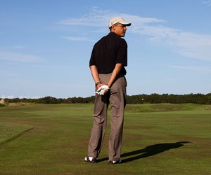 Obama golfs while on vacation in 2009.