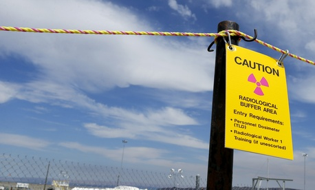 "A sign warns of radioactivity near a wind direction flag indicator at the ""C"" tank farm on the Hanford Nuclear Reservation near Richland, Wash., July 9, 2014."