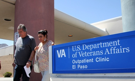 A Texas couple exit the Vetarans Affairs facility in El Paso, June 9, 2014.