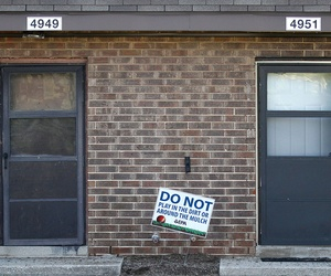 In this Aug. 23, 2016 photo, a sign from the Environmental Protection Agency is posted in front of West Calumet Housing Complex houses at East Chicago, Ind.