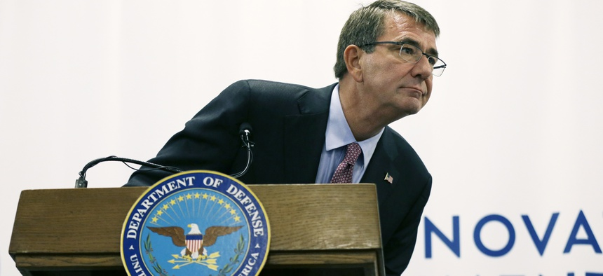 Defense Secretary Ash Carter leans to listen to a reporter's question during a news conference, Tuesday, July 26, 2016, in Cambridge, Mass. Carter appeared in Cambridge to formally open the second office of the Defense Innovation Unit Experimental.