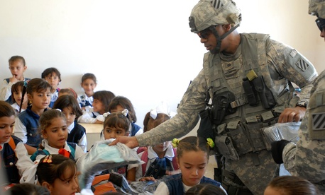 The U.S. Army 4th Battalion, 64th Armor Regiment, distributed backpacks to Iraqi children in a 2008 deployment.