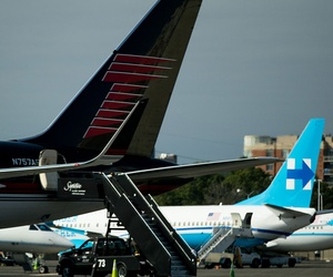 The campaign planes for Hillary Clinton and Donald Trump are parked nearby each other on the tarmac at Washington's Ronald Reagan National Airport, Friday.