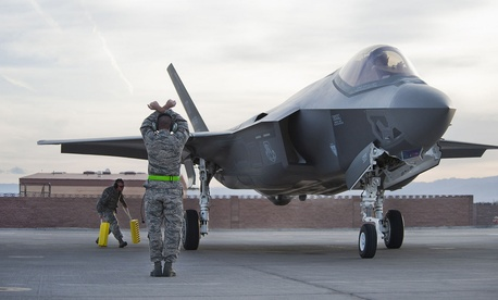 Crew chiefs from the 57th Wing Lightning Aircraft Maintenance Unit marshal an F-35 Lighting II, March 6, 2013, at Nellis Air Force Base, Nev.