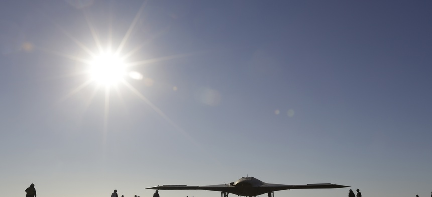 The Navy experimental unmanned aircraft, the X-47B, taxies to it's launch position on the flight deck aboard the nuclear powered aircraft carrier USS Theodore Roosevelt, off the Virginia coast, Sunday, Nov. 10, 2013.