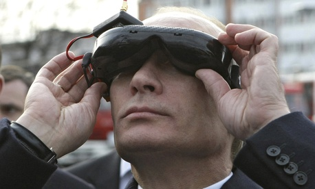 Russian Prime Minister Vladimir Putin tests goggles with an electronic connection that allows him to see the view from an unmanned drone aircraft, during an exhibition of equipment displayed at Russia's Civil Defense Academy in Moscow's Khimki surburbs.