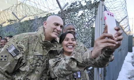 U.S. Army Staff Sgt. Austina Knotek takes a photo with the United States Army Chief of Staff, Gen. Ray Odierno in Kabul, Afghanistan, February 7, 2014.