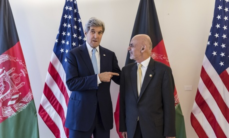 U.S. Secretary of State John Kerry, left, talks with Afghanistan's President Ashraf Ghani during a Conference on Afghanistan in Brussels, Tuesday, Oct. 4, 2016.
