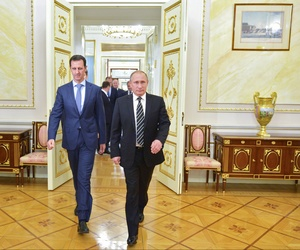 Russian President Vladimir Putin, right, and Syria President Bashar Assad arrive for their meeting in the Kremlin in Moscow, Russia, Oct. 20, 2015.