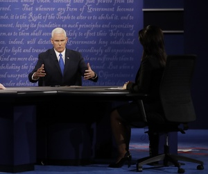 Democratic vice-presidential nominee Sen. Tim Kaine, left, listens to Republican vice-presidential nominee Gov. Mike Pence during the vice-presidential debate at Longwood University in Farmville, Va., Tuesday, Oct. 4, 2016.