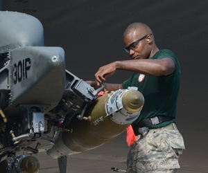 Staff Sgt. Stefano Cothran, a 2nd Aircraft Maintenance Squadron weapons load team member, secures a GBU-38 Joint Direct Attack Munition to a pylon during the 2014 Global Strike Challenge on Barksdale Air Force Base, La., Aug. 27, 2014.
