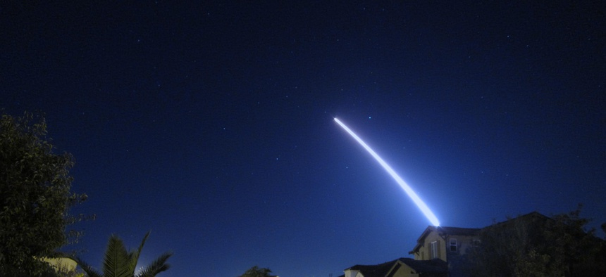 An operational test launch of an unarmed Minuteman III intercontinental ballistic missile from Vandenberg Air Force Base, Calif., is seen from nearby Lompoc, Calif., Sept. 26, 2013.