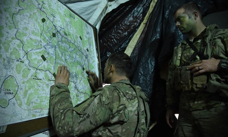 U.S. soldiers track unit movements on a map during Exercise Allied Spirit V at the 7th Army Training Command's Hohenfels Training Area, Germany, Oct. 8, 2016.