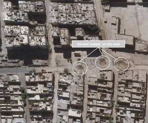 This satellite images released by the United Nations, shows road damage and craters, in the Sha'ar district of Aleppo, Syria, Sept. 25, 2016.