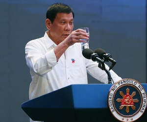 Philippine President Rodrigo Duterte makes a toast during his address to a Filipino business sector in suburban Pasay city south of Manila, Philippines Thursday, Oct. 13, 2016.