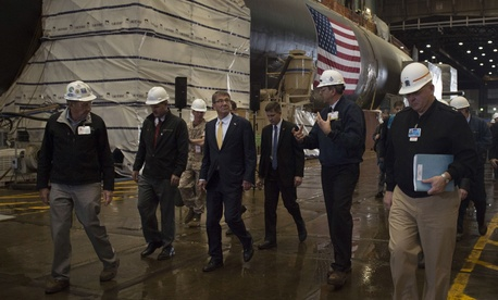 Secretary of Defense Ash Carter walks with General Dynamics Electric Boat Facility leaders as he tours the facility in New London, Conn., during a visit May 24, 2016.