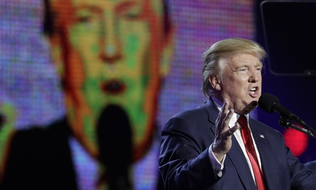 Republican presidential candidate Donald Trump is seen on a large screen as he speaks during a charity event hosted by the Republican Hindu Coalition, Saturday, Oct. 15, 2016, in Edison, N.J.