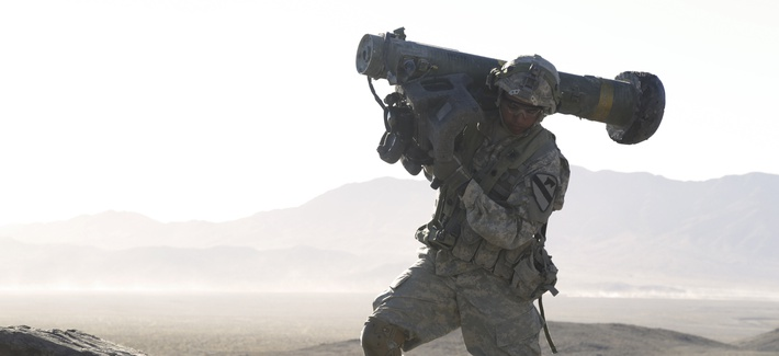 A U.S. Soldier assigned to 1st Battalion, 12th Cavalry Regiment, 3rd Brigade Combat Team, 1st Cavalry Division, carries a Javelin shoulder-fired anti-tank missile during Decisive Action Rotation 17-01 at the National Training Center in Fort Irwin, Calif.,