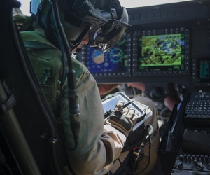 A U.S. Marine pilot uses a tablet during an urban close air support exercise in Yodaville, Ariz., Sept. 30, 2016.