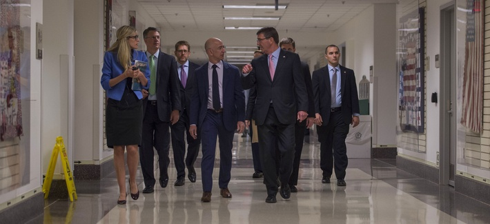 Secretary of Defense Ash Carter speaks with Jeff Bezos, Founder, Chairman & CEO of Amazon.com as they tour the Pentagon during a visit May 5 , 2016.