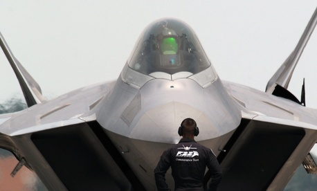 The U.S. Air Force's F-22 Raptor Demonstration Team prepares to take off from Offutt Air Force Base, Neb., for the 2014 Defenders of Freedom Open House and Air Show July 19, 2014.
