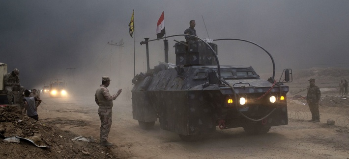 A vehicle from the U.S.-trained Iraqi Federal Police passes through a checkpoint in Qayara, some 31 miles, 50 km, south of Mosul, Iraq, Oct. 26, 2016.