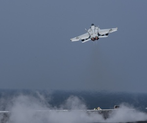 An F/A-18E Super Hornet assigned to the Gunslingers of Strike Fighter Squadron (VFA) 105 launches from the flight deck of the aircraft carrier USS Dwight D. Eisenhower (CVN 69).