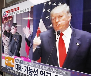 A TV screen shows pictures of U.S. President-elect Donald Trump, right, and North Korean leader Kim Jong Un, at the Seoul Railway Station in Seoul, South Korea, Thursday, Nov. 10, 2016.