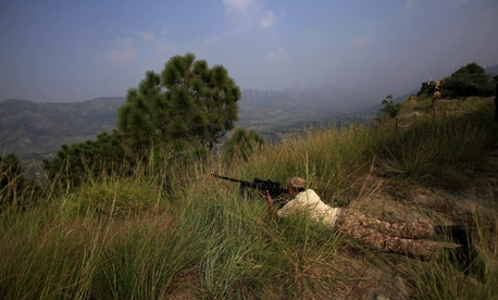 Pakistan army soldiers take position at a forward area Bagsar post on the Line of Control (LOC), that divides Kashmir between Pakistan and India, in Bhimber, some 103 miles, 166 km, from Islamabad, Pakistan, Oct. 1, 2016.