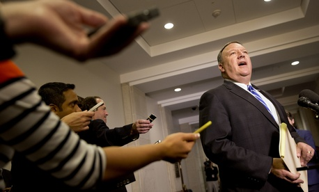 Reporters hold out recorders as House Benghazi Committee member Rep. Mike Pompeo, R-Kansas, speaks to the media on Capitol Hill in Washington, Friday, Oct. 16, 2015.