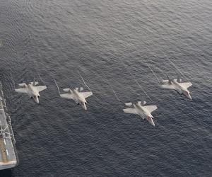 F-35B perform maneuvers above the USS America on Sunday, November 20, 2016.